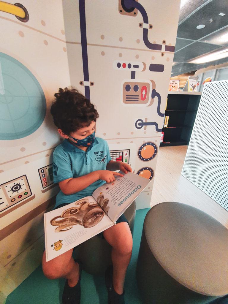 Adam reading the Children's Library
