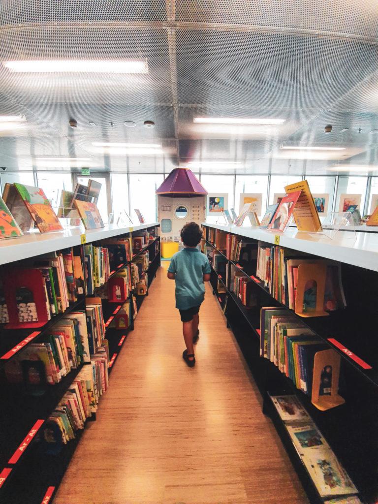 Adam exploring the children's library
